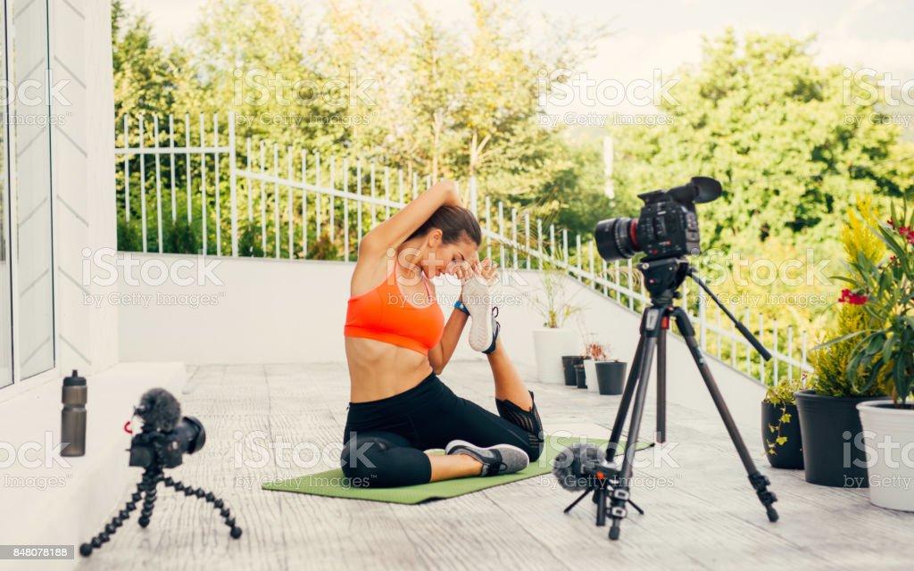 Woman doing an exercise vlog stock photo