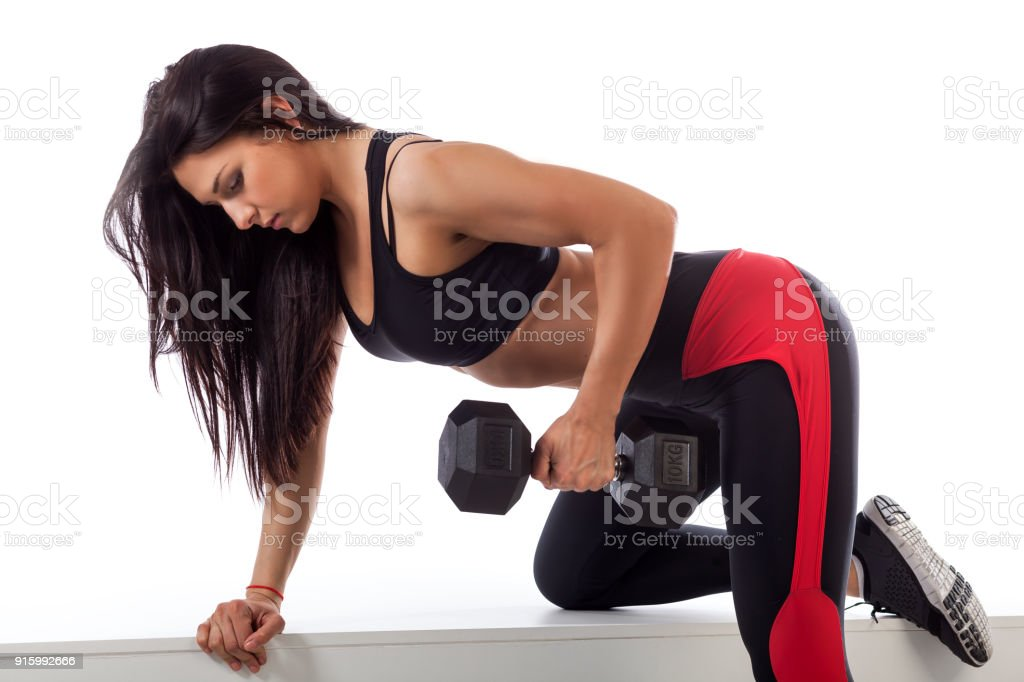 woman doing an exercise with a dumbbell stock photo