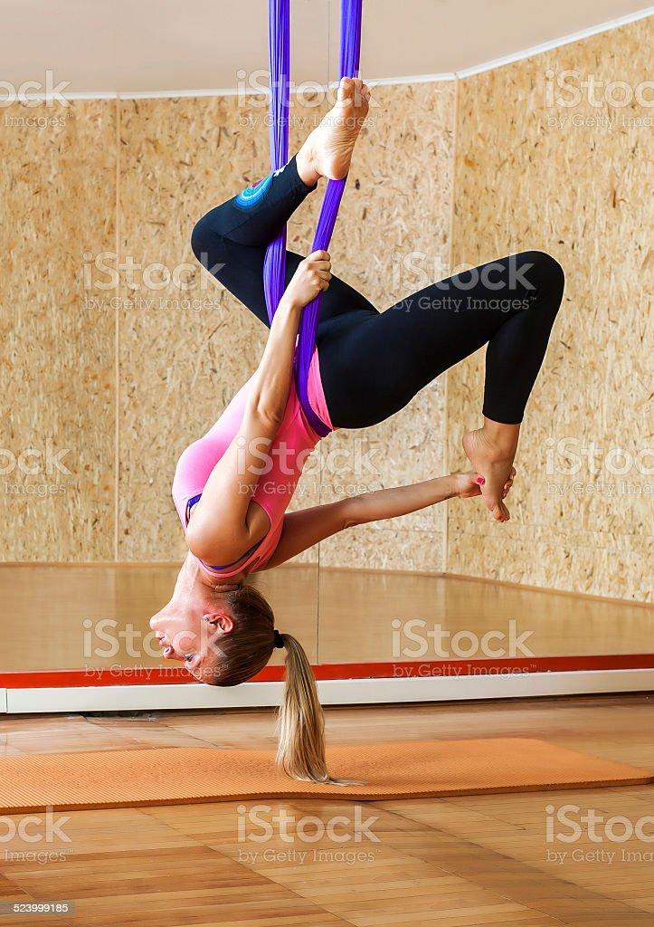 Woman doing antigravity Aerial yoga stock photo