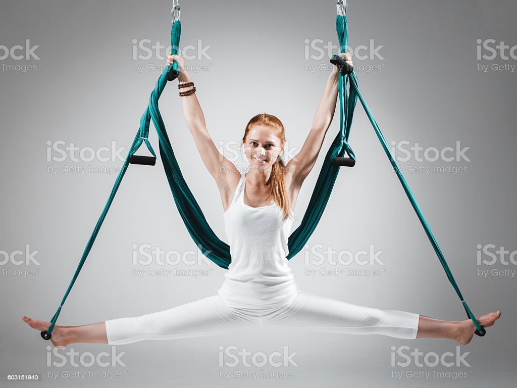 woman doing antigravity fly aerial yoga positions in hammock royalty free stock photo woman doing antigravity fly aerial yoga positions in hammock stock      rh   istockphoto