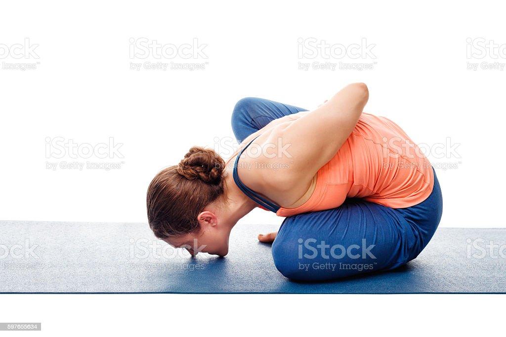 Woman doing Ashtanga Vinyasa Yoga asana Marichyasana B stock photo