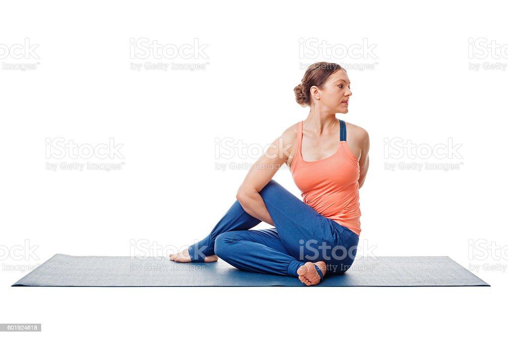 Woman doing Ashtanga Vinyasa Yoga asana  Marichyasana D stock photo
