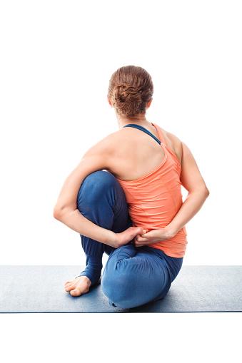 Woman Doing Ashtanga Vinyasa Yoga Asana Marichyasana D Stock Photo - Download Image Now