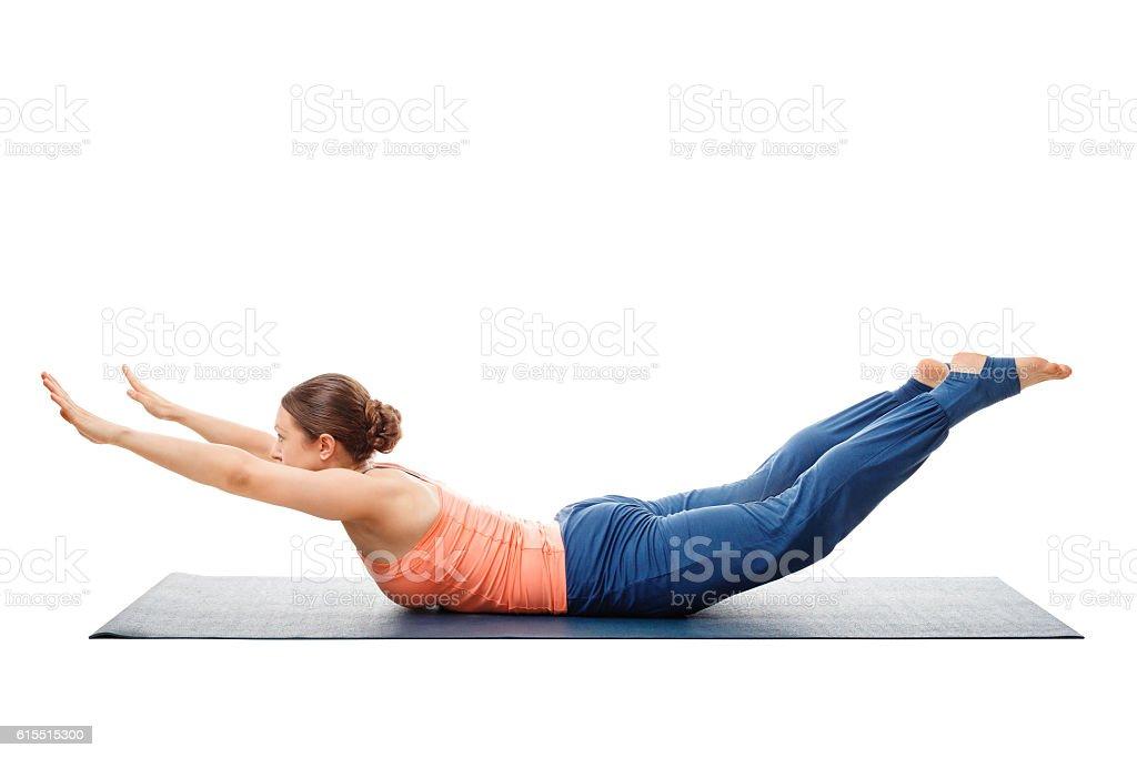 Woman doing Ashtanga Vinyasa Yoga asana Salabhasana stock photo