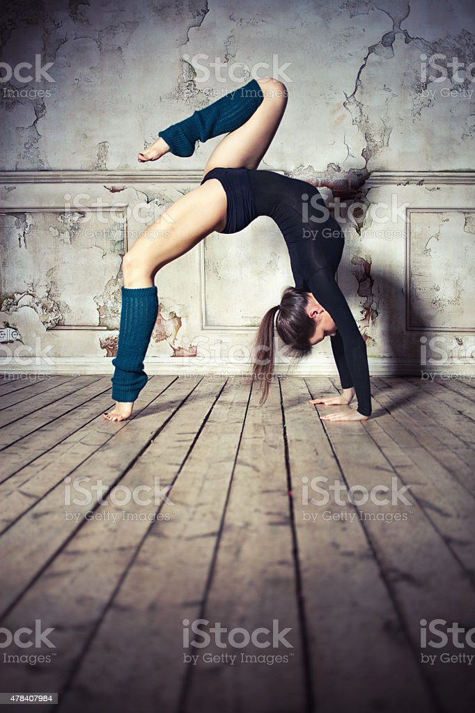 Woman doing backbend stock photo