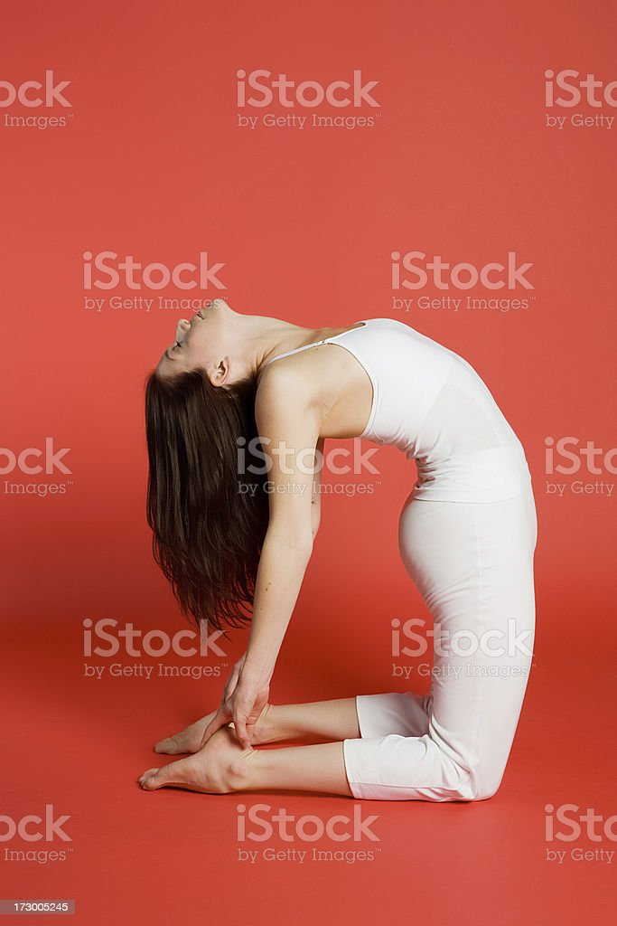 Woman doing camel pose royalty-free stock photo