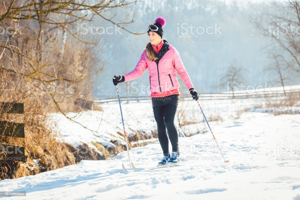 Woman doing cross country skiing as winter sport stock photo