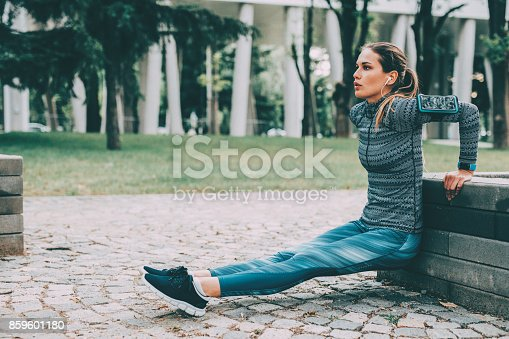 istock Woman doing dips outdoors 859601180
