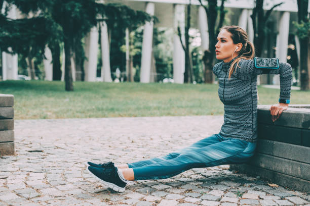 Woman doing dips outdoors Woman doing dips in the city. bicep stock pictures, royalty-free photos & images