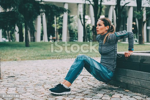 Woman doing dips in the city.