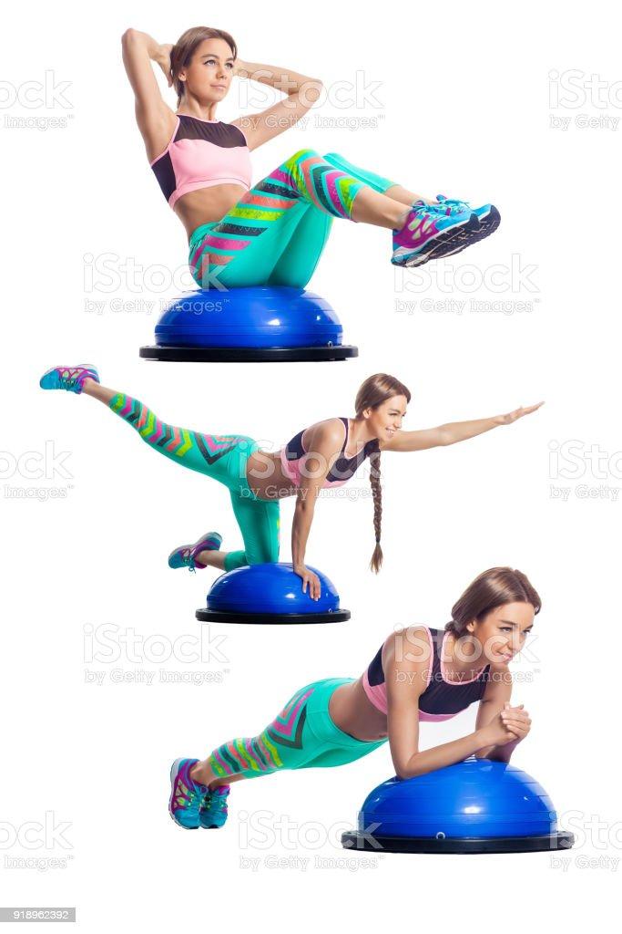 woman doing exercise on bosu stock photo