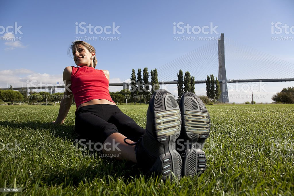woman doing exercise outdoor royalty-free stock photo