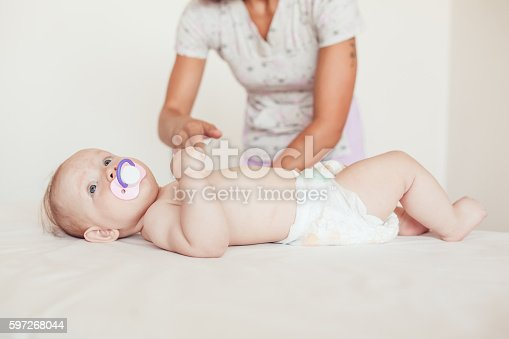 Woman Doing Exercises And Massage The Baby Stock Photo & More Pictures of Activity