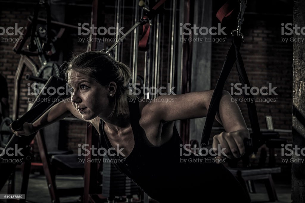 woman doing exercises in the gym stock photo