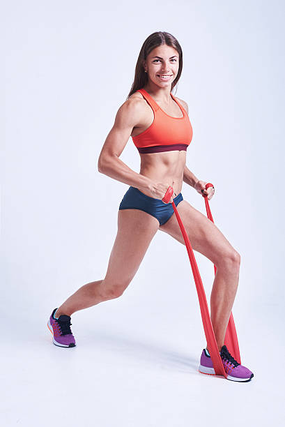 Woman doing exercises with resistance band. Fitness, workout, sport, training, - foto de stock