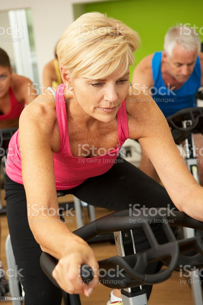 Woman Doing Spinning Class In Gym royalty-free stock photo