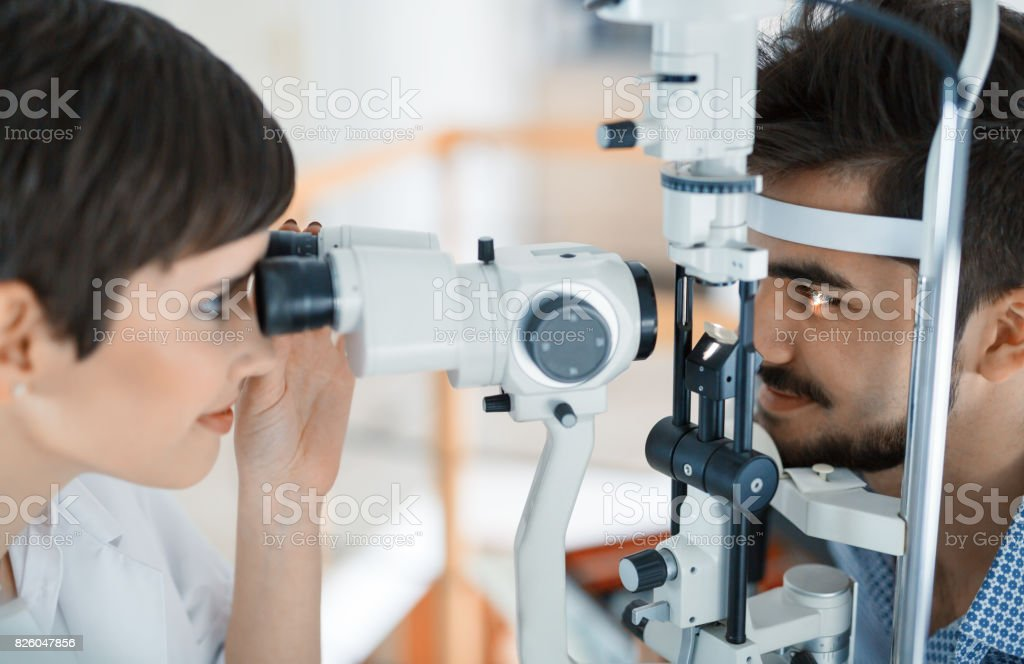 Woman doing eye test with optometrist in eye sight clinic stock photo
