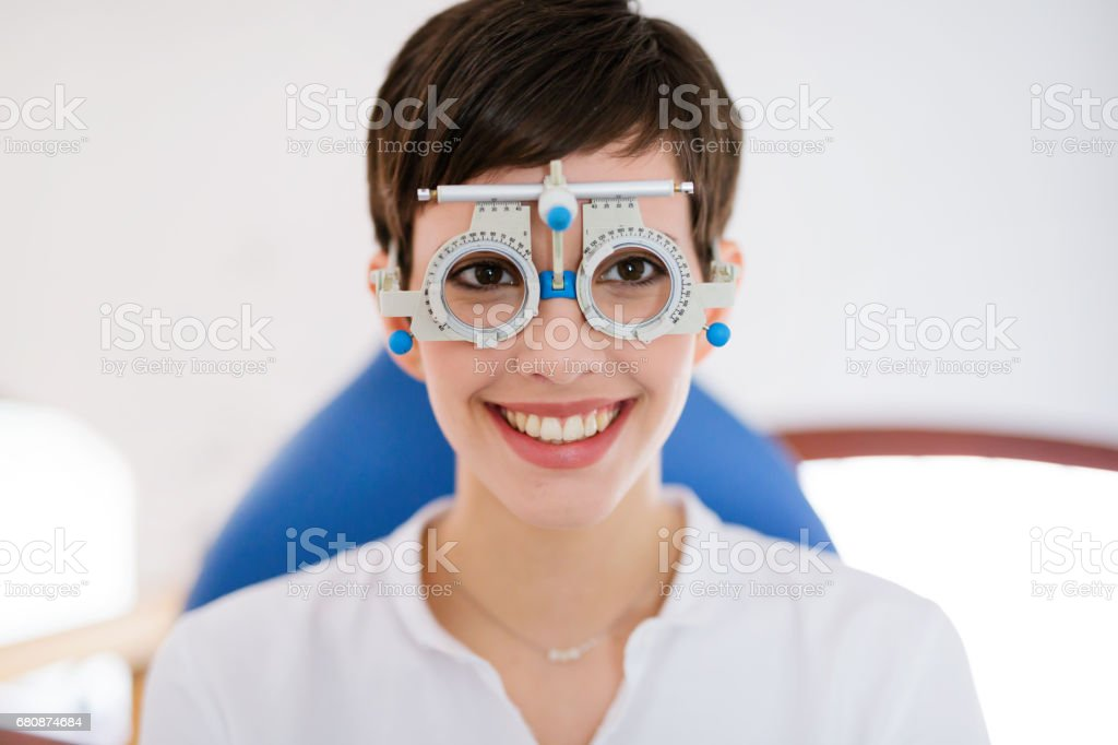 Woman doing eye test with optometrist in medical center stock photo