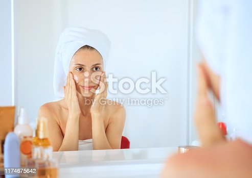 istock Woman doing face care 1174675642