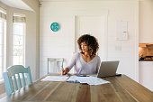 istock Woman Doing Finances at Home 1172587378