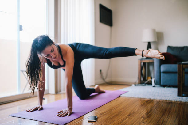 Woman doing fitness at home in Los Angeles stock photo