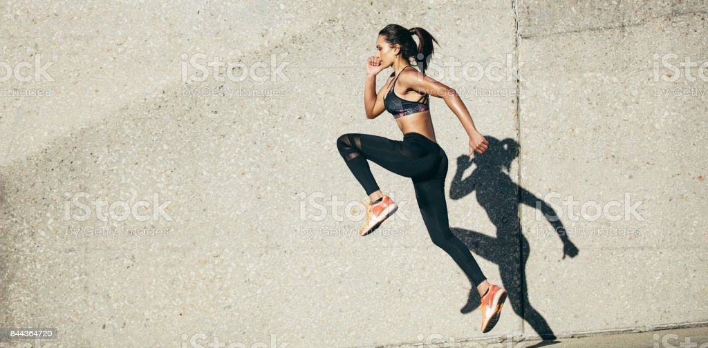 Woman doing fitness exercise outdoors - foto stock