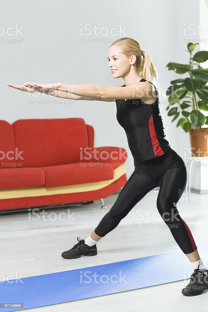 Woman doing fitness exercises at home stock photo