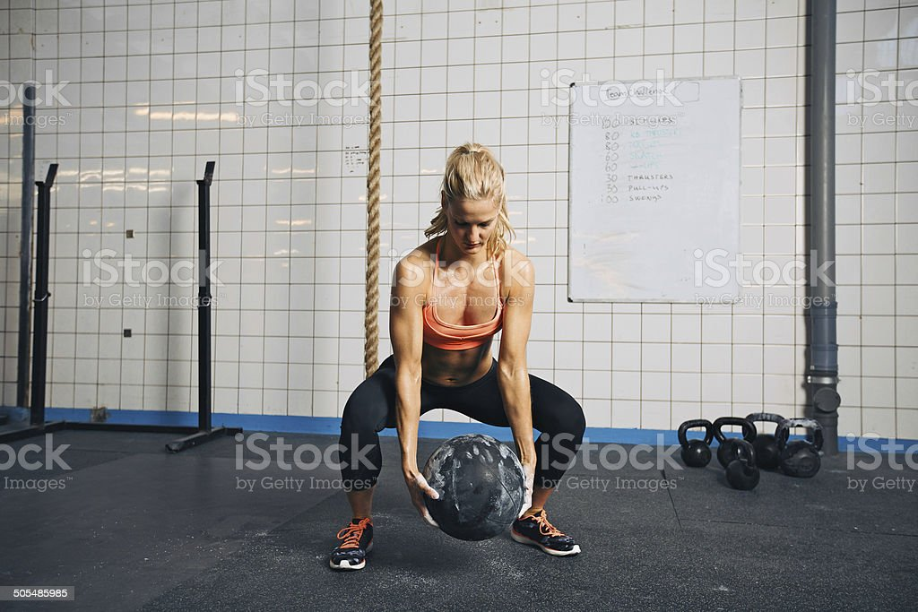 Woman doing gym workout with medicine ball  at gym stock photo