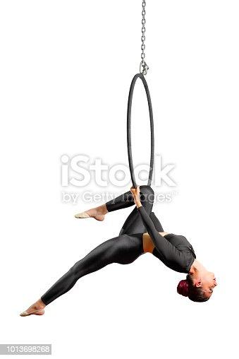 istock Woman doing gymnastic exercises on the hoop 1013698268