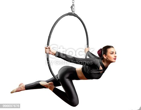 istock Woman doing gymnastic exercises on the ring 996697676