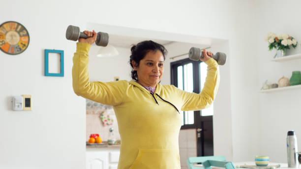 woman doing gymnastics relaxation - showus стоковые фото и изображения