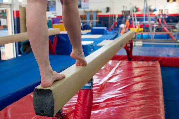 woman doing gymnastics training - balance beam stock photos and pictures