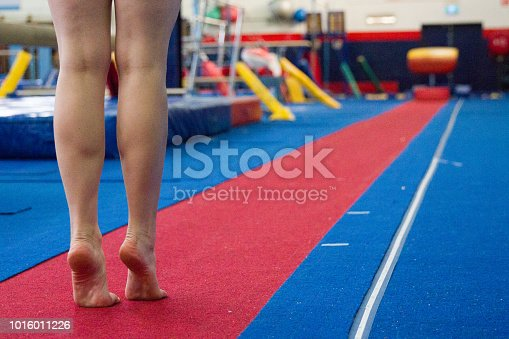 Gymnast preparing to do vault training