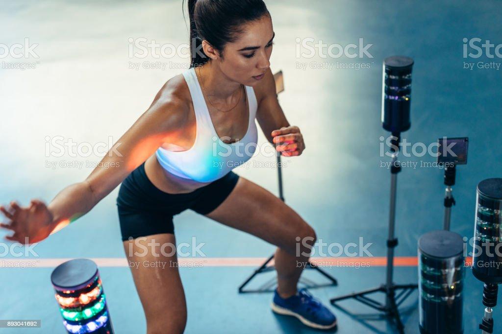 Woman doing hand eye reaction training stock photo