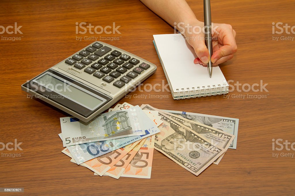 Woman doing her accounting, financial adviser working royalty-free stock photo
