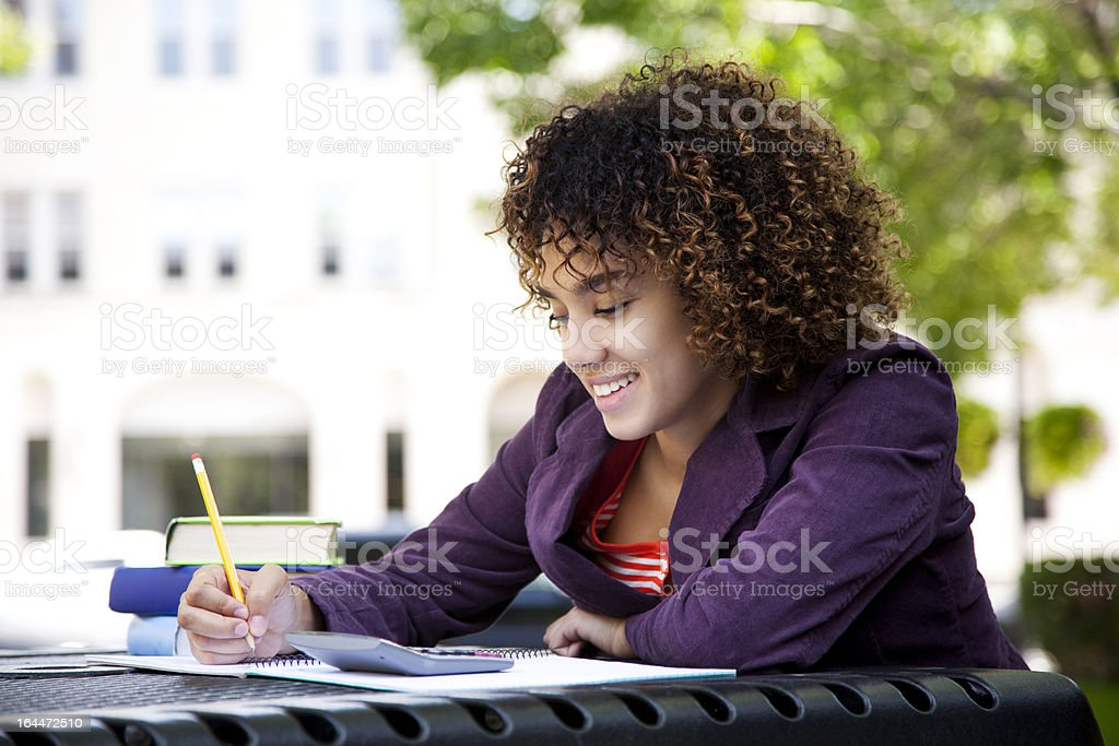Woman doing her homework royalty-free stock photo