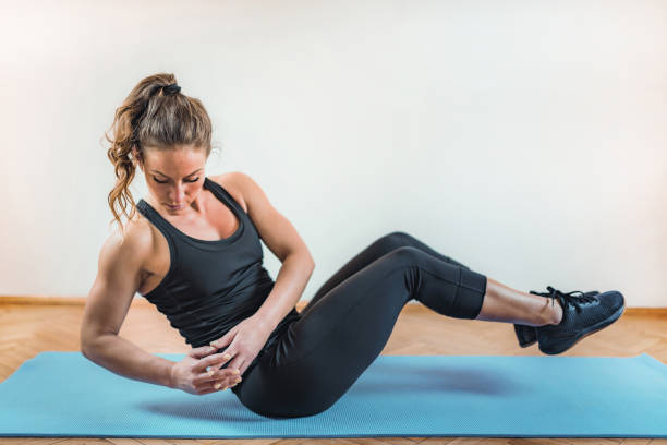 Woman Doing High-Intensity Interval Training Exercises stock photo