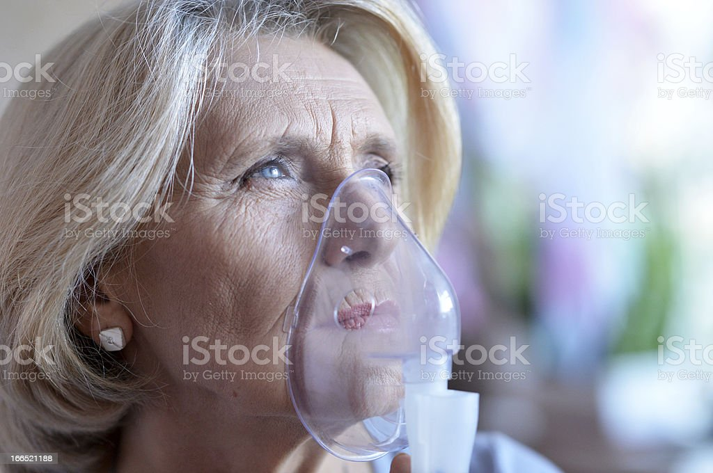 woman doing inhalation royalty-free stock photo