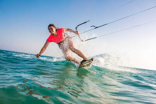Woman doing kitesurfing