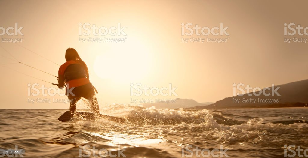 Woman doing kitesurfing - Royalty-free 18-19 Years Stock Photo