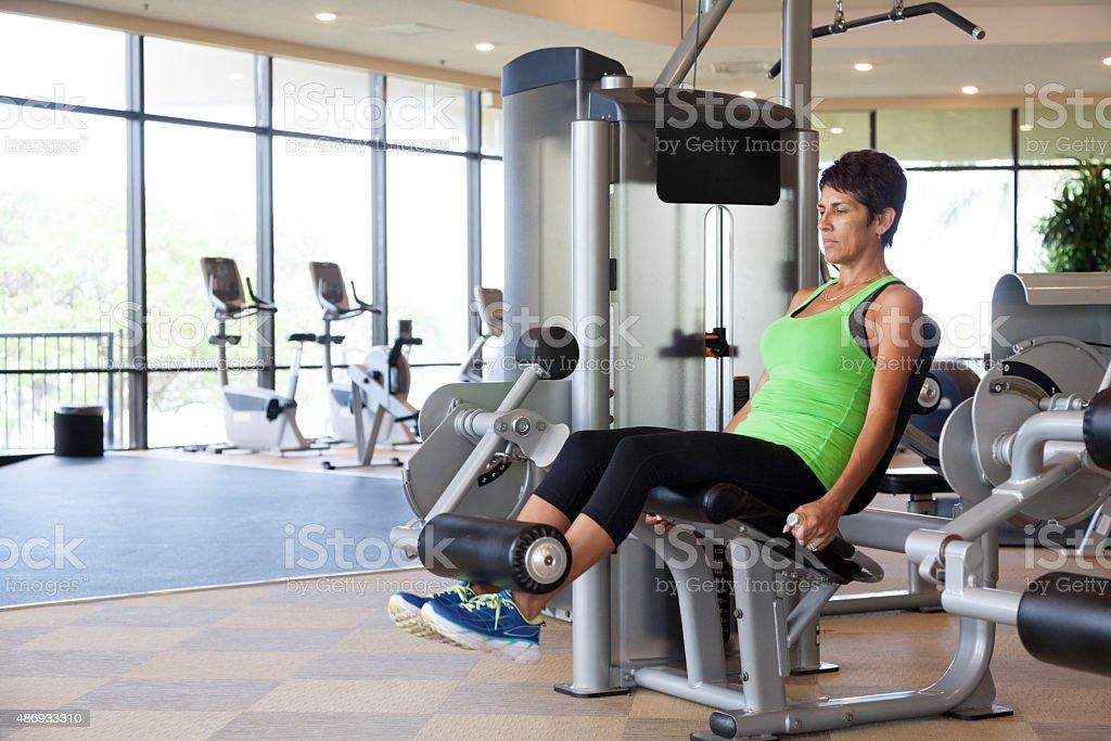 Woman Doing Leg Extensions stock photo