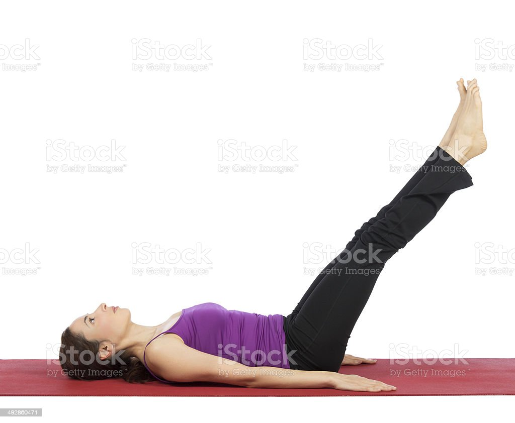 Woman doing legs and abs workout stock photo