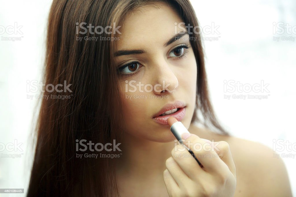 woman doing makeup royalty-free stock photo