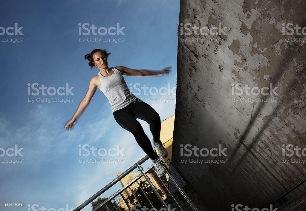 Woman doing Parkour Tic-Tac stock photo