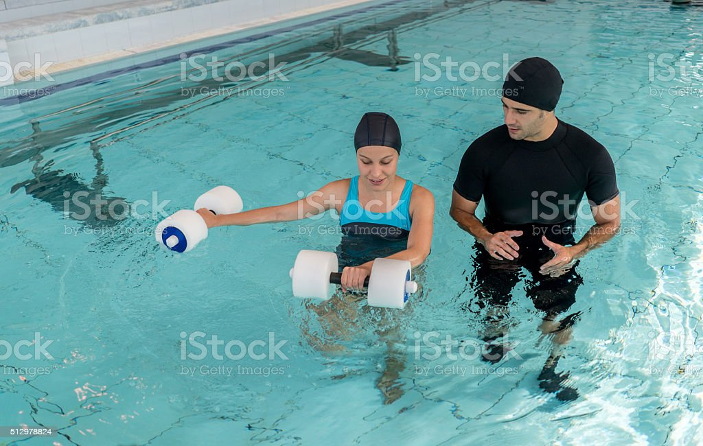 Woman doing physical therapy in the water stock photo