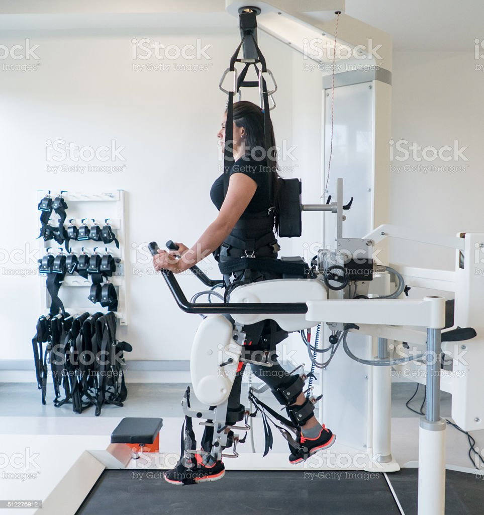 Woman doing  physical therapy on a machine stock photo