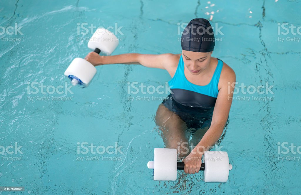 Woman doing physiotherapy exercises in the water stock photo