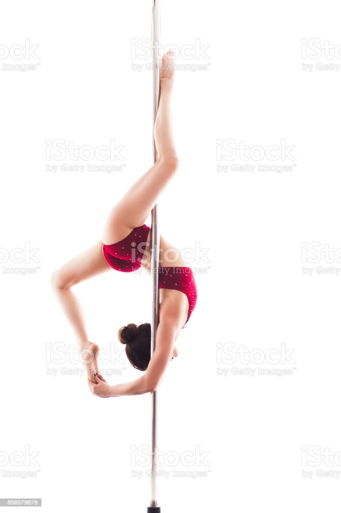 Woman doing pole dance, isolated on white stock photo