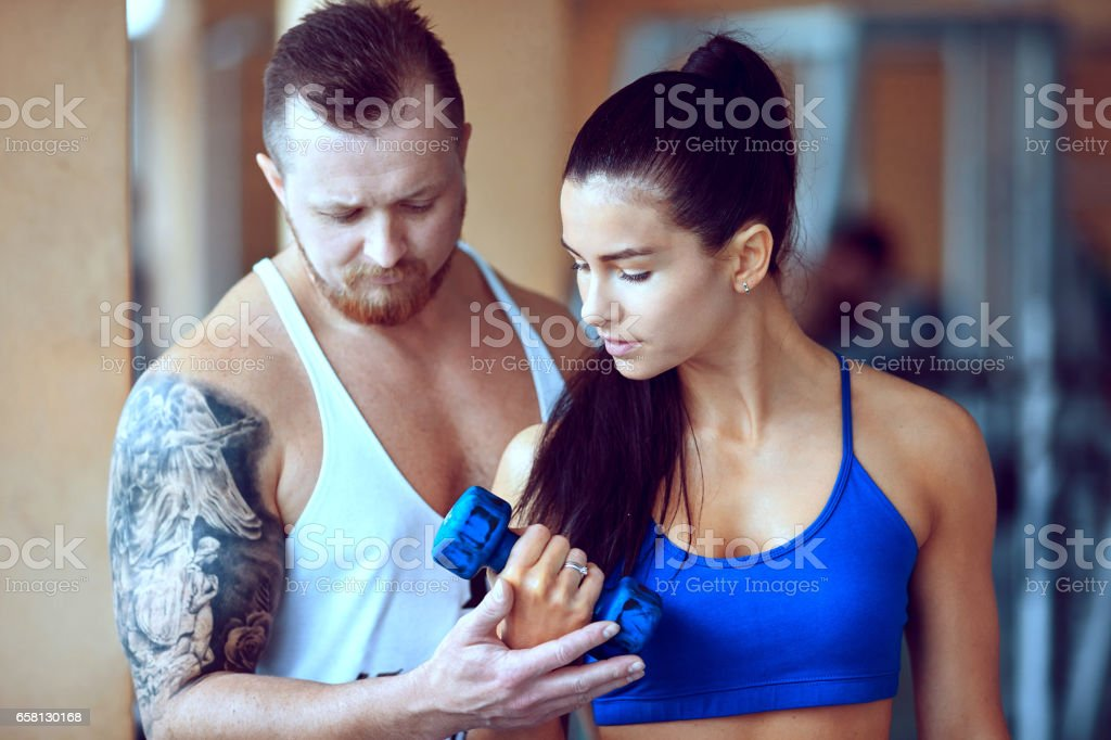 woman doing push exercise under supervision of a trainer royalty-free stock photo