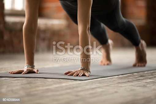 istock Woman doing Push ups or press ups exercise, close up 924059544